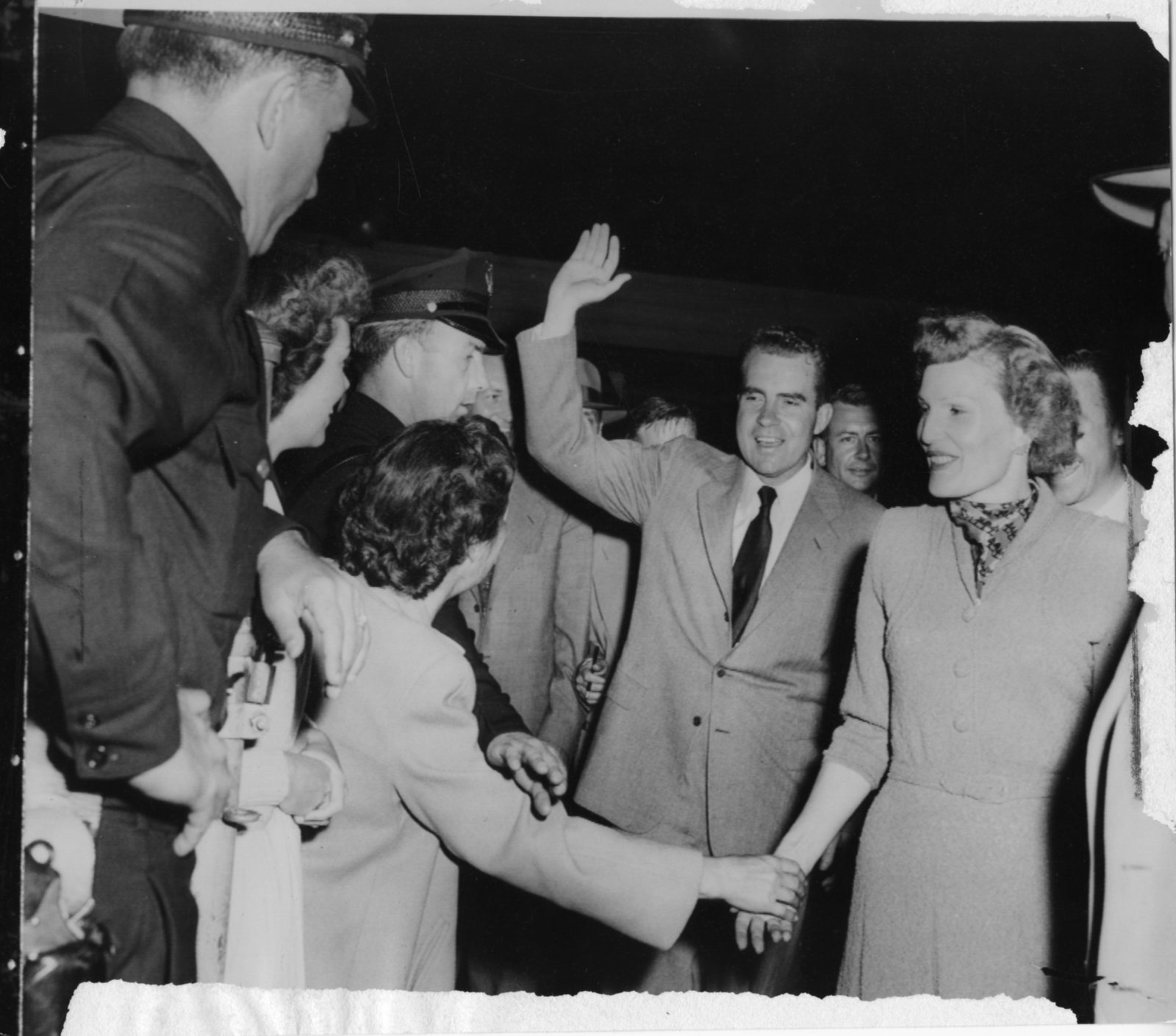 Supporters surround Richard and Pat Nixon in Los Angeles on the day of Nixon's televised Checkers Speech