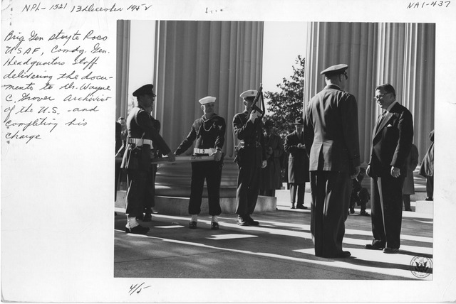 Photograph of Brigadier General Stoyte Ross USAF, Comdg. Gen Headquarters Staff Delivering the Documents to Dr. Wayne C. Grover Archivist of the United States