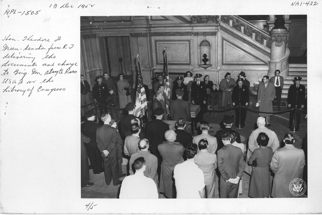 Photograph of Hon.. Theodore J. Green, Senator from Rhode Island, Delivering the Documents and Charge to Brigadier General Stoyte Ross USAF at the Library of Congress