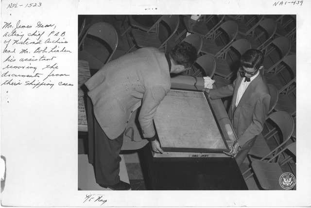 Photograph of Mr. James Gear of the National Archives and Mr. Bob Linden his Assistant Removing the Documents from their Shipping Cases