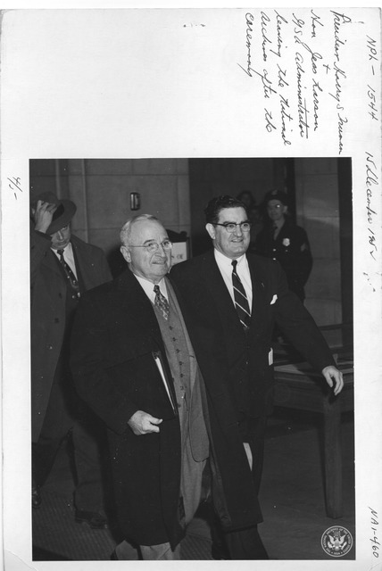 Photograph of President Harry S. Truman and Hon. Jess Larson, General Services Administration (GSA) Administrator, Leaving the National Archives after the Unveiling Ceremony