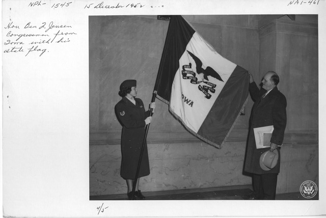 Photograph of the Honorable Ben J. Jensen, Congressman from Iowa, with His State Flag
