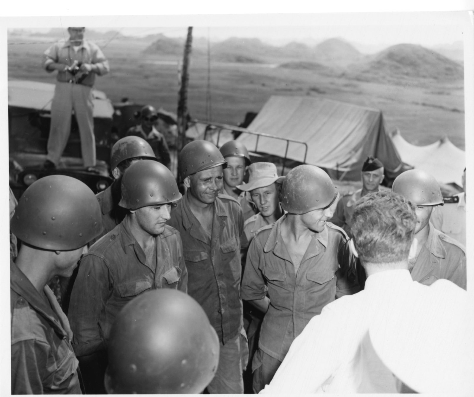 Richard Nixon inspects troops in Vietnam during his Far East Tour