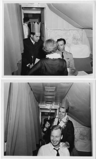 Richard Nixon wears a King Neptune hat (made out of a paper bag) while speaking to Pat Nixon and George Martin, Commander of the aircraft