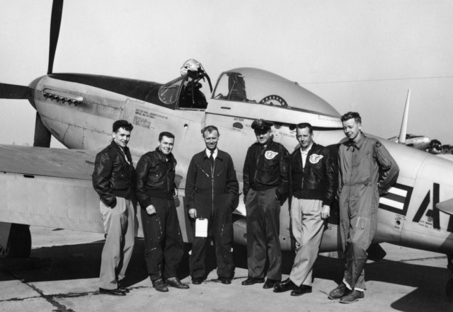 """U.S. Air Force personnel assigned to the 119th Fighter Wing""""Happy Hooligans"""", North Dakota Air National Guard, pose for a photo in front of a F-51D Mustang aircraft, sometime in 1953. Pictured left-to-right, Thornton E. Becklund; Robert Olwin; Thomas Marking; and Duane""""Pappy""""Larson. (A3604) (U.S. Air Force PHOTO) (Released)"""