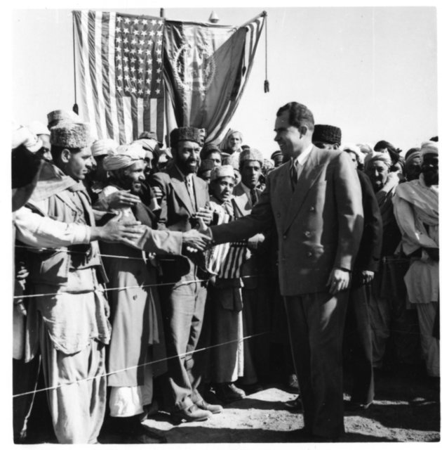 Vice President Richard Nixon shakes hands with locals in Afghanistan