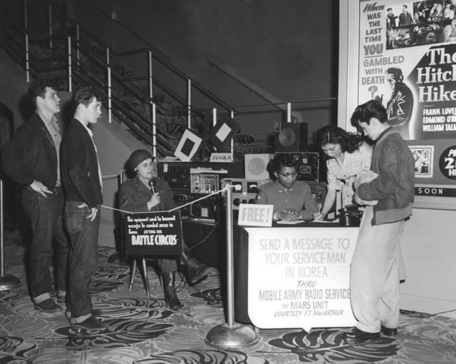 During Veteran's Day weekend in 1953, Sergeant Dieter Kaisenberg and his team from U.S. Army Radio W6USA at Fort McArthur, California set up a mobile station in the lobby of the renowned United Artist Theatre in downtown Los Angeles. Passersby were invited to give them messages that were transmitted to friends and relatives in Korea