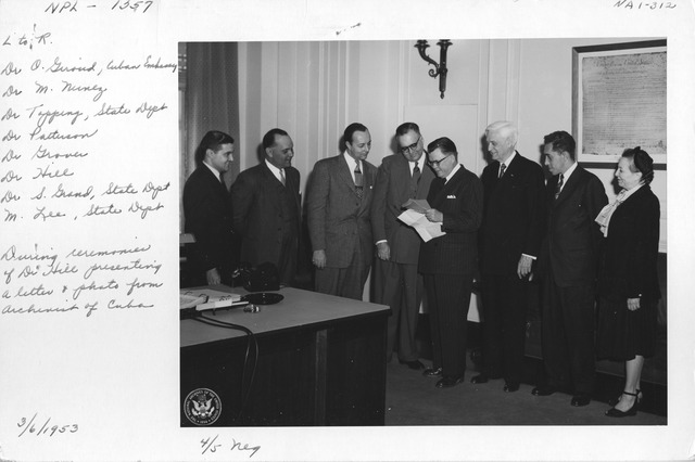Photograph of Dr. O. Giroud, Dr. M. Nunez, Dr. Topping, State Department, Dr. Patterson, Dr. Grover, Dr. Hill, Dr. S. Grand, State Department, M. Lee, State Department, during Ceremonies of Dr. Hill Presenting a Letter and Photo from the Archivist of Cuba