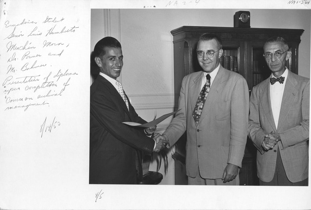 Photograph of Ecuadorian Student Senor Luis Humberto Merchan Mora, Dr. Ernst Posner and Mr. Robert Bahmer during Presentation of a Diploma upon Completion of Course on Archival Management