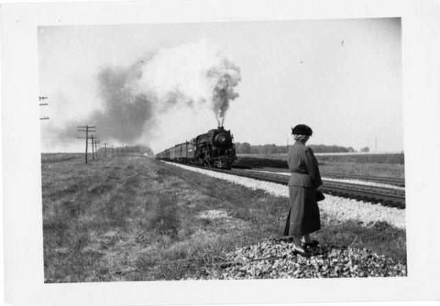"A woman awaits the arrival of the ""Dick Nixon Campaign Special"" train (Richard Nixon's campaign train) in Ohio"