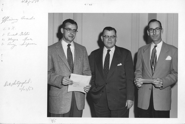 Photograph of Efficiency Award ceremony. Left to Right: Ernest Galdi, Wayne Grover, and Acey Simpson