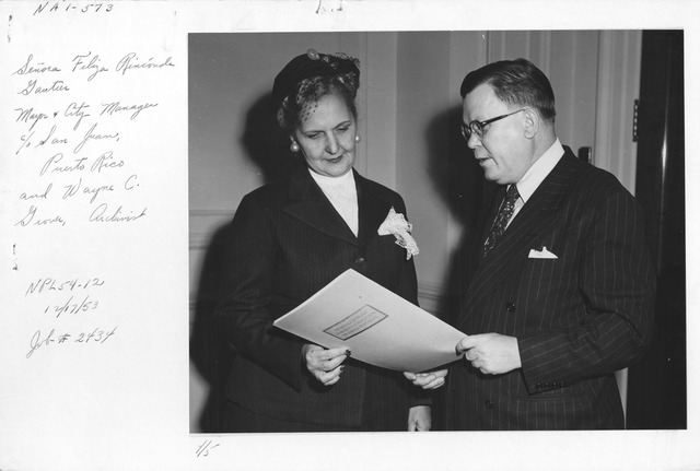 Photograph of Senora Feliza Rinconde Gautier, Mayor and City Manager of San Juan, Puerto Rico and Wayne C. Grover, Archivist