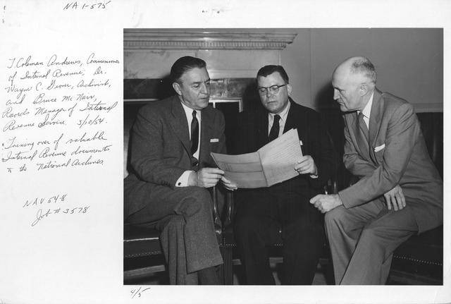Photograph of J. Coleman Andrews, Commissioner of Internal Revenue, Dr. Wayne C. Grover, Archivist, and Bruce McNair, Records Manager of Internal Revenue Service Turning over Valuable Internal Revenue Documents to the National Archives