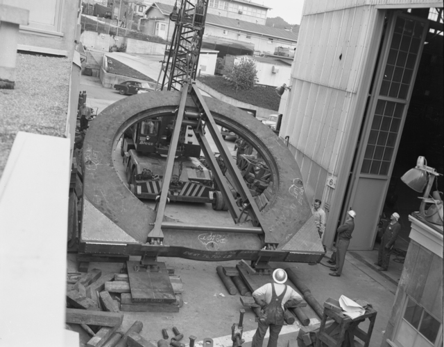 "184-inch cyclotron. Moving auxiliary magnet coil into Bldg. 6. Photo taken 3/19/1954. 184""-1230 Principal Investigator/Project: Analog Conversion Project"
