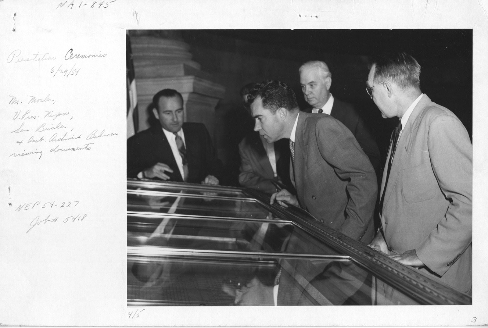 Photograph of Presentation Ceremonies, Mr. Mosler, Vice President Richard Nixon, Senator Bricker, and Assistant Archivist Bahmer Viewing Documents