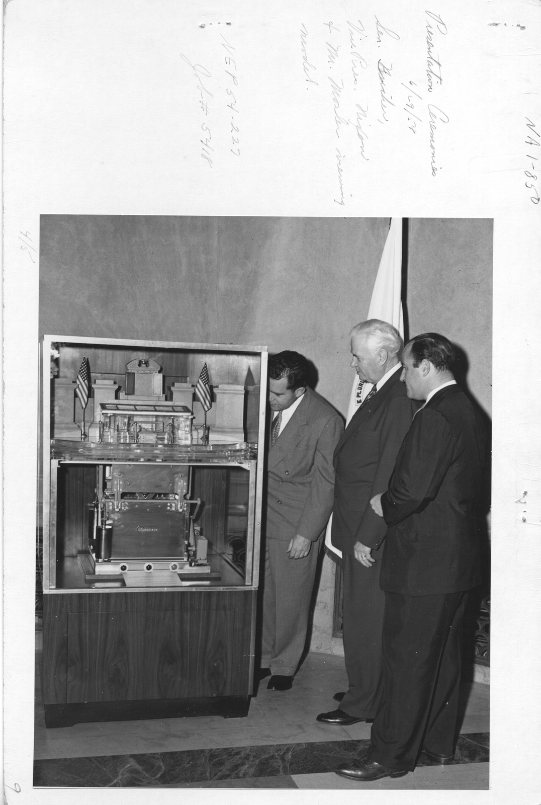 Photograph of Presentation Ceremonies, Mr. Mosler, Vice President Richard Nixon, Senator Bricker Viewing Model