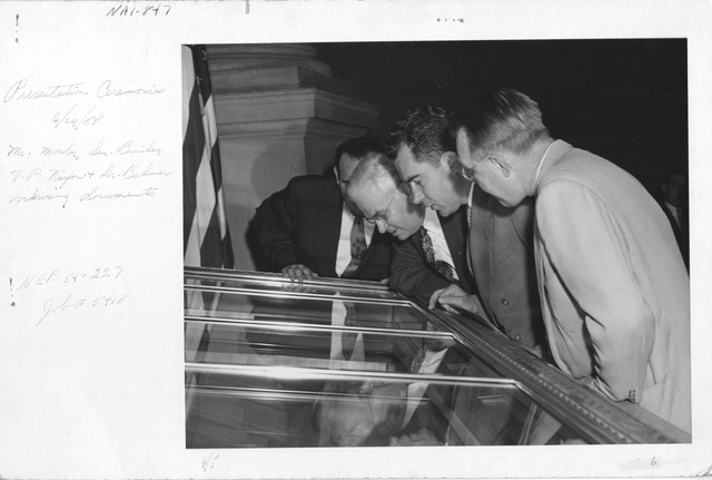 Photograph of Presentation Ceremonies, Mr. Mosler, Vice President Richard Nixon, Senator Bricker, and Assistant Archivist Bahmer Viewing Documents