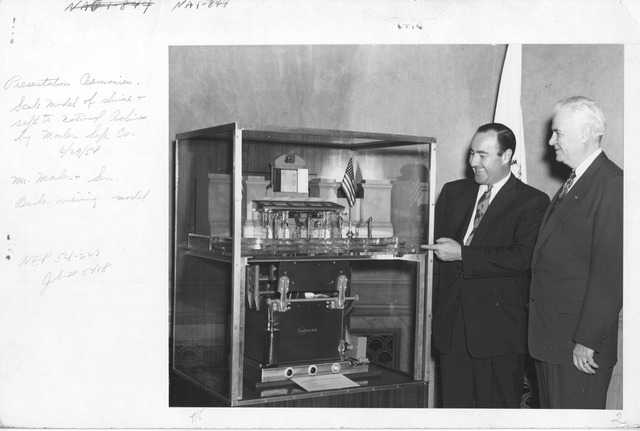 Photograph of Presentation Ceremonies of Scale Model of Shrine and Safe to National Archives by Mosler Safe Co., Mr. Mosler and Senator Bricker Viewing Model