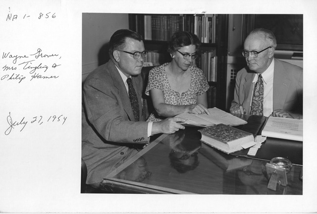 Photograph of Archivist Wayne C. Grover with Mrs. Marion Tinling and Philip M. Hamer of the National Historical Publications Commission.  They are viewing Thomas Lloyd's shorthand notes of the First Congress of the United States, 1789-1790.