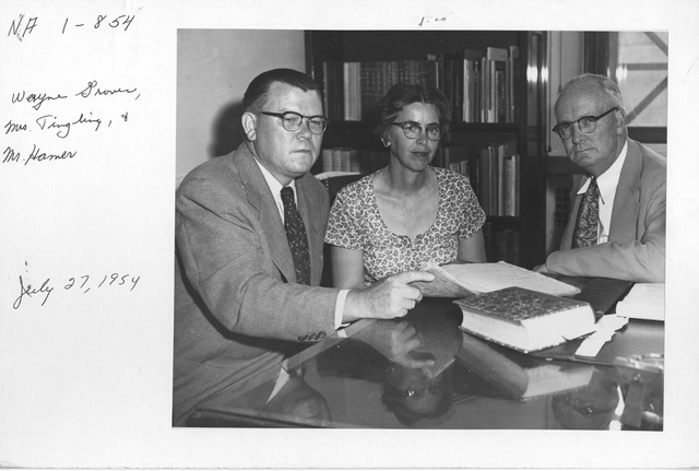 Photograph of Archivist Wayne Grover with Mrs. Marion Tinling and Philip M. Hamer of the National Historical Publications Commission.  They are viewing Thomas Lloyd's shorthand notes of the First Congress of the United States, 1789-1790.