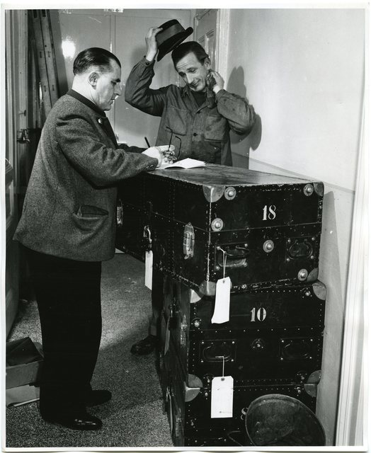 Mr. Walter Pretzmann, an Employee in the Central Management Bureau of Wolfsegg-Traunthaler Coal Mining Company in Linz, Signs for Three Trunks Full of Books Sent by the Vienna U.S. Information Center