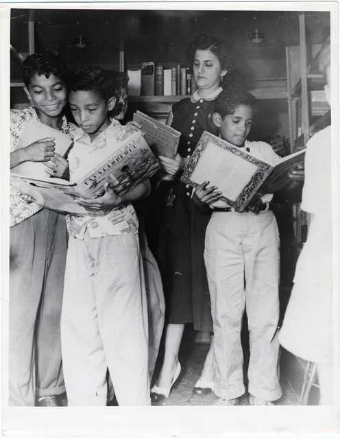 Showing Children's Books to Boys in Bookmobile, Panama City