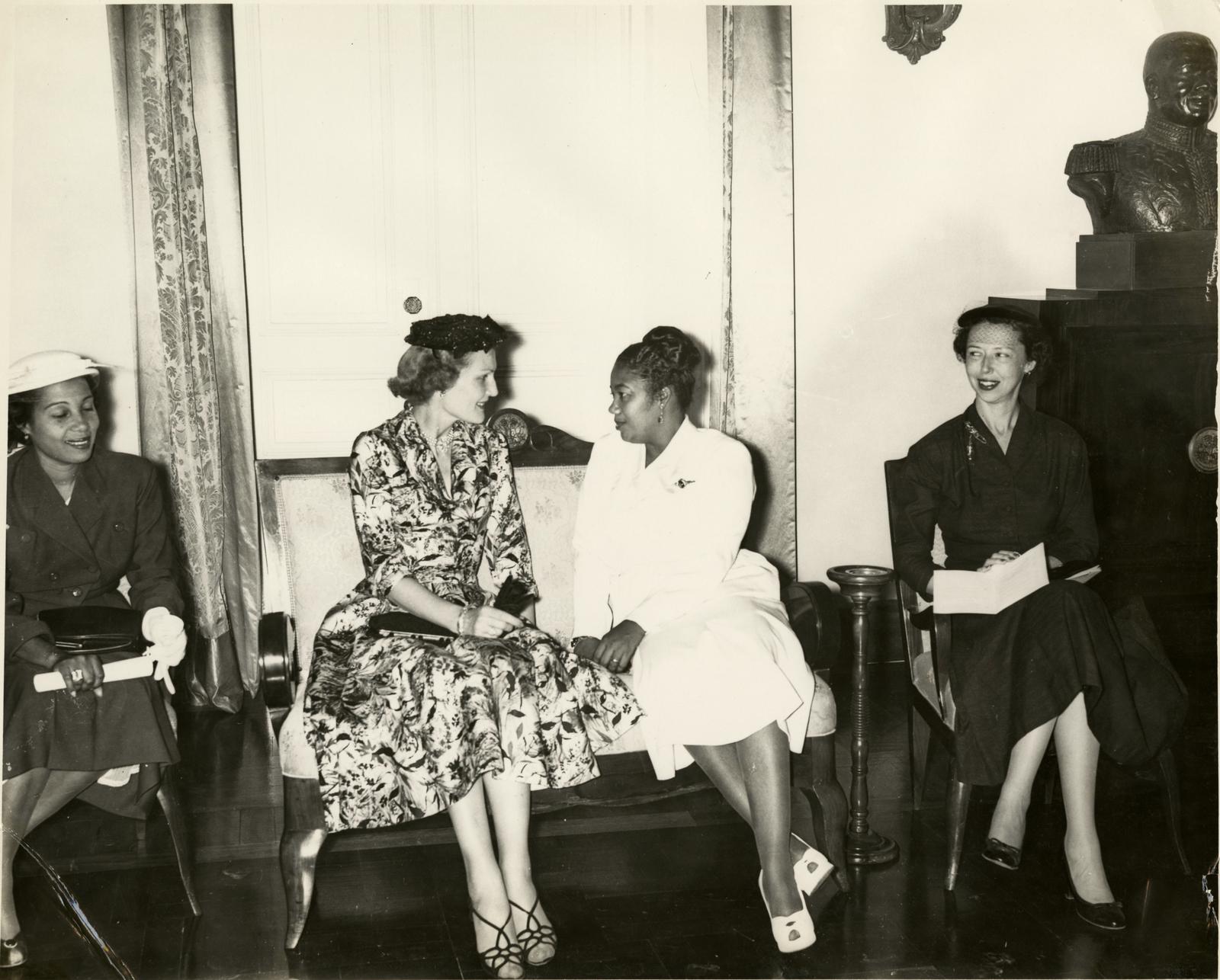 Pat Nixon seated with Yolette Leconte Magloire during Richard Nixon's trip to visit Haiti ruler Paul Magloire