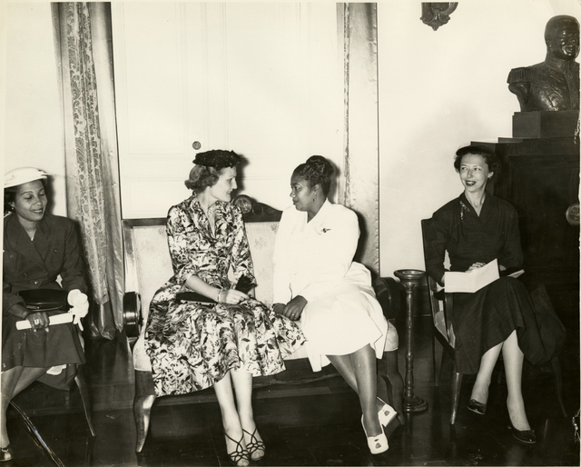 Pat Nixon seated with Yolette Leconte Magloire during Richard Nixon's trip to visit Haiti ruler Paul Magloire