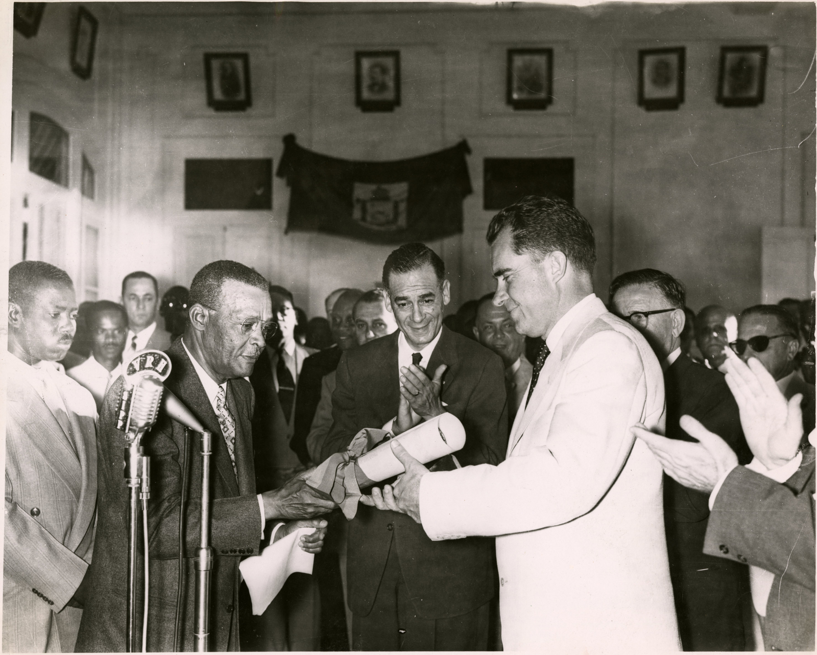 Vice President Richard Nixon receives a certificate making him an Honorary Citizen of Port-au-Prince at City Hall in Haiti