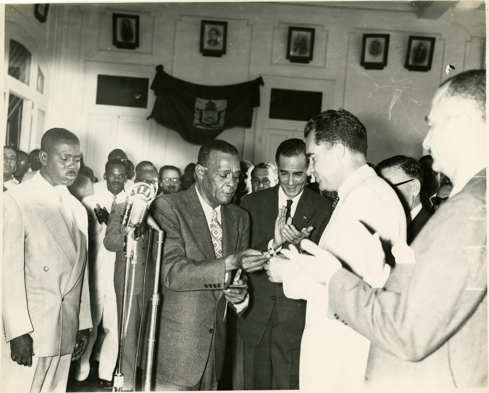 Vice President Richard Nixon receives a key to the city in Port-au-Prince, Haiti