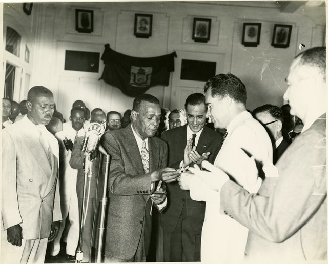 Vice President Richard Nixon receives a key to the city in Port-au-Prince, Haiti