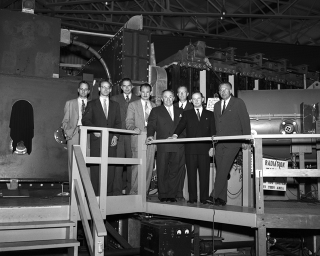 Visiting dignitaries from South America touring the Bevatron with Edward Lofgren (second from left), Glenn T. Seaborg (third from left), Edwin McMillan (fourth from left), Luis Alvarez (third from right), and Ernest Orlando Lawrence (right) taken April 11, 1955. Morgue 1955-5 (P-2) [Photographer: Donald Cooksey]