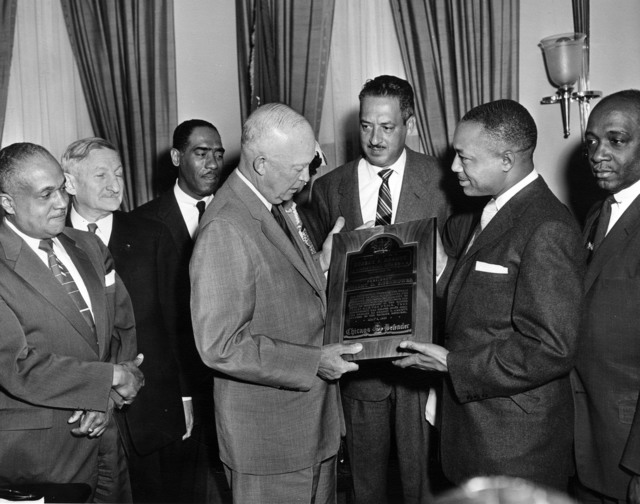 Photograph of John H. Sengstacke, Publisher of the Chicago Defender, Presenting President Dwight D. Eisenhower with the Robert Abbott Award