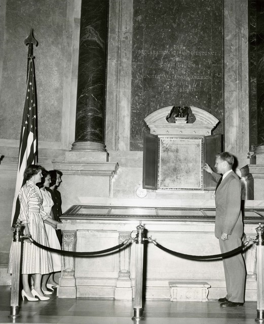 Photograph of Representative Gerald Ford Pointing Out the Declaration of Independence to Three Constituents in the Rotunda at the National Archives in Washington, DC