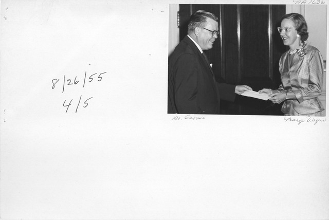 Photograph of Dr. Wayne Grover Presenting Award to Marjorie T. Wagus at National Archives and Records Service Awards Ceremony