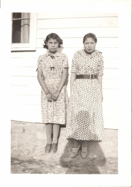 Amelia Lakota and Eva Red Ear Horse Wearing Dresses They Made