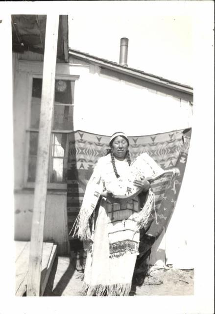 Mrs. Charlie Thunder Bull and Beaded Cradle Made for Her First Grandchild