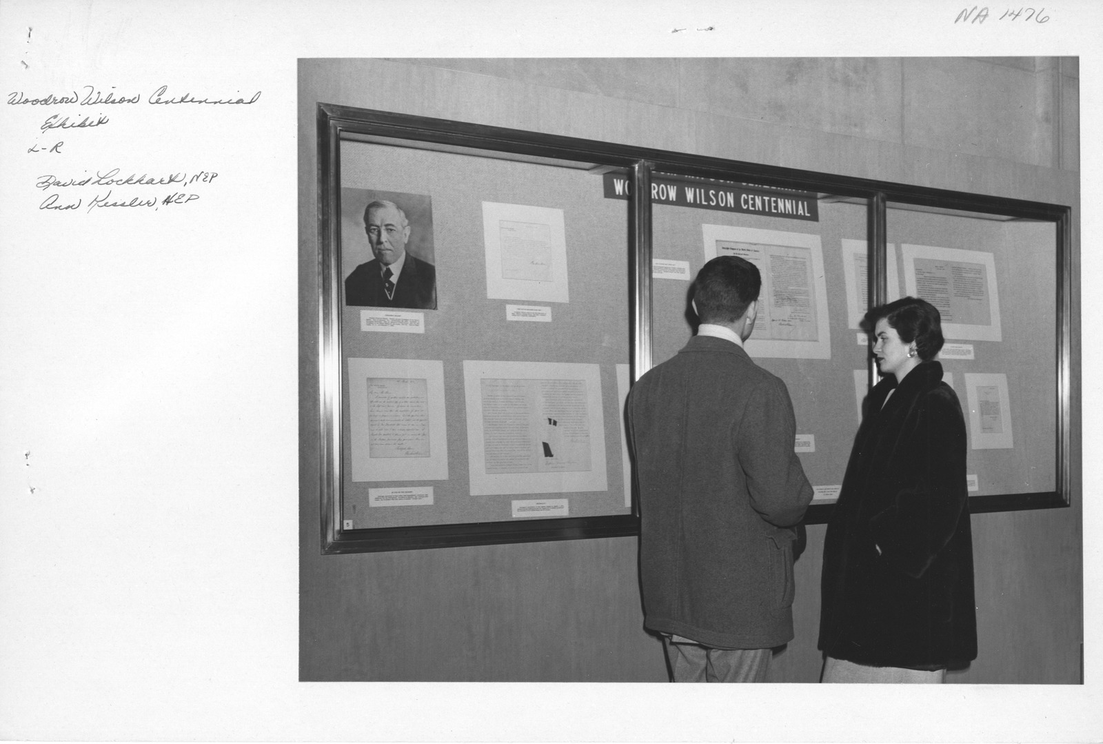 Photograph of Ann Kessler and David Lockhart (Exhibits and Publications) Viewing the Woodrow Wilson Centennial Exhibit