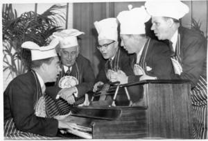 Richard Nixon plays the piano during a birthday party given to him by fellow members of the Chowder and Marching Club of Washington. L-R: Nixon, Kenneth Keating, Charles Potter, Donald Jackson, and William Ayres
