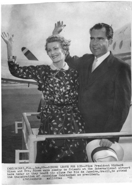 Richard Nixon and Pat Nixon wave goodbye in Miami as they board a plane for Rio Janeiro to attend the inauguration of Jasceline Kubitschek as Brazil President
