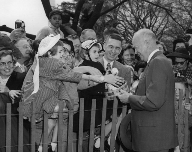 President Dwight D. Eisenhower Greets the Crowd who have come for the Easter Egg Roll on the South Lawn of the White House
