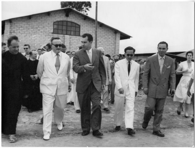 Richard Nixon and officials tour a facility during Nixon's trip to South Vietnam