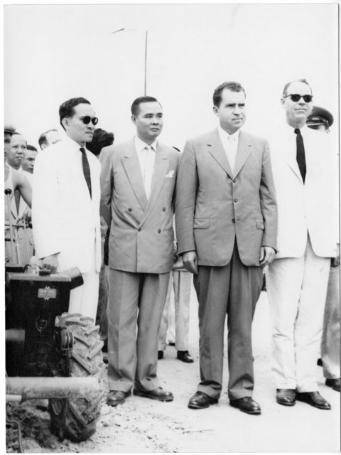 Richard Nixon stands with officials in South Vietnam