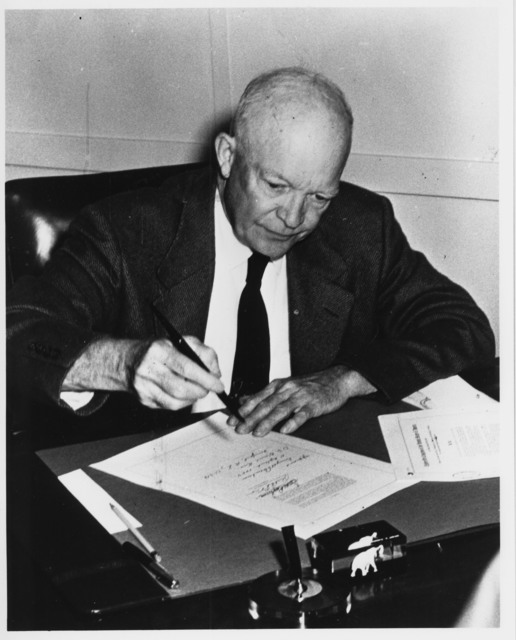 Photograph of President Dwight D. Eisenhower Signing the Civil Rights Act of 1957 (H.R. 6127) in His Office at the Naval Base in Newport, Rhode Island