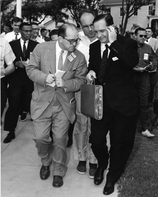 Arkansas Governor Orval E. Faubus Besieged by Newsmen following His Two Hour Conference with President Dwight D. Eisenhower at the Naval Base in Newport, Rhode Island