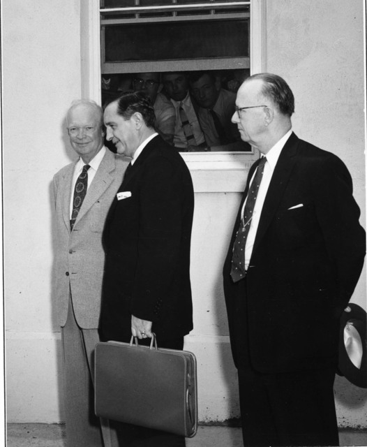 Photograph of President Dwight D. Eisenhower, Arkansas Governor Orval E. Faubus and Arkansas Congressman Brooks Hays at the Naval Base in Newport, Rhode Island, following a Two Hour Conference on the Little Rock School Integration Controversy