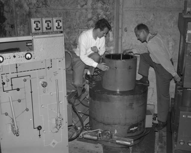 Propane bubble chamber with Warren Chupp and Dick Lander taken September 19, 1957. Morgue 1957-7 (P-1) [Photographer: Donald Cooksey]