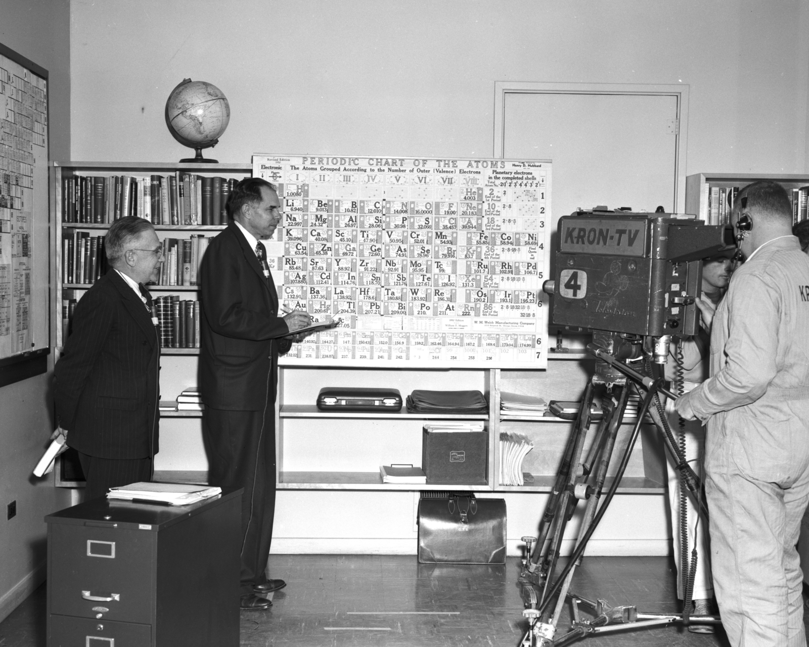 """Emilio Segre and Glenn Seaborg in filming for the TV show, """"Wide, Wide World"""". Produced 10/08/1957. Morgue 1958-25 (P-19) [Photographer: Donald Cooksey]"""