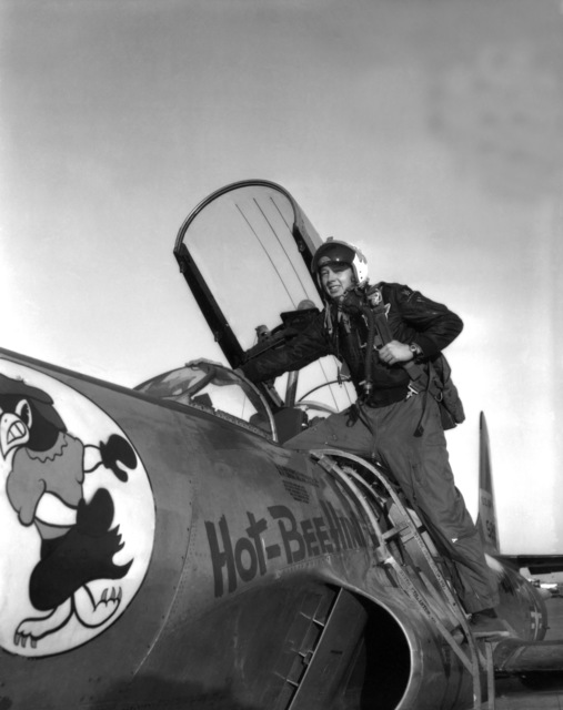 """U.S. Air Force Brig. GEN. Thornton E.""""BECK""""Becklund, 119th Fighter Wing""""Happy Hooligans"""", North Dakota Air National Guard, climbs into the cockpit of a F-94 A/C Starfire aircraft at Hector Field, North Dakota. The""""Happy Hooligan""""pilots flew the F-94 A/C Starfire aircraft from 1954-to-1960. (A3604) (U.S. Air Force PHOTO) (Released)"""