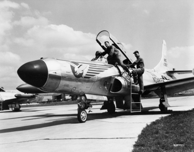 """U.S. Air Force personnel assigned to the 119th Fighter Wing""""Happy Hooligans"""", North Dakota Air National Guard, Robert Groom and Neil Modin, photographed with their F-94 A/C Starfire aircraft at Hector Field, North Dakota. The""""Happy Hooligan""""pilots flew the F-94 A/C Starfire aircraft from 1954-to-1960. (A3604) (U.S. Air Force PHOTO) (Released)"""